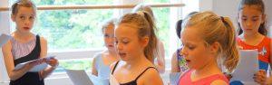 Young theatre school pupils practice a scene